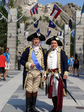 Gene Pisasale at Mount Rushmore with General Washington (portrayed by Carl Closs)